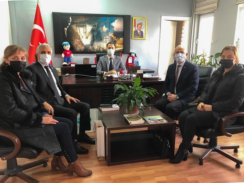 DATÜB heyeti, Erzincan İl Göç İdaresi Müdürü Kaan Özlok'u ziyaret etti